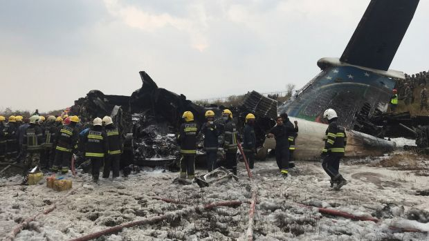 Wreckage of an airplane is pictured as rescue workers operate at Kathmandu airport, Nepal on March 12th, 2018. Photograph: Navesh Chitrakar/Reuters