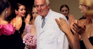 "French fashion designer Hubert de Givenchy, creator of the ""ittle black dress"", has died. He was 91. Here he is applauded by models after he presented his last High Fashion collection at the 1995 Paris autumn/winter fashion show. Photograph: Reuters"
