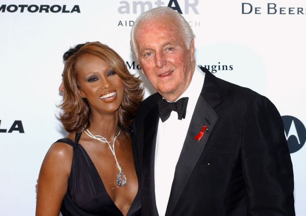 With model Iman at the amFar (American Foundation for Aids Research) benefit party in Mougins, near Cannes., in 2002. Photograph: AFP