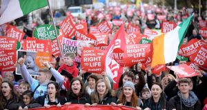 Marchers  in  Dublin  campaigning  for the Eighth Amendment of the Constitution to be retained. Photograph:  Caroline Quinn/PA Wire