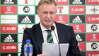 Northern Ireland manager Michael O'Neill reads a statement at his press conference on Monday. Photograph: Jonathan Porter/Inpho