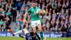 Rob Kearney is tackled by  Scotland's Blair Kinghorn: The fullback has played a key role in four championship wins plus a Grand Slam. Photograph:  Tom Honan.