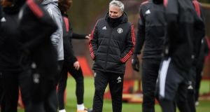 José Mourinho at  team training   on the eve of   Manchester United's  Champions League   match against Sevilla.  Photograph: Getty Images