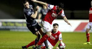 St Pats' Ryan Brennan and Robbie Benson of Dundalk fight for the ball. Photograph: Ryan Byrne/Inpho