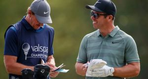 Paul Casey, right, laughs with his caddie John McClaren during the final round of the Valspar Championship. Photo: Mike Carlson/AP Photo