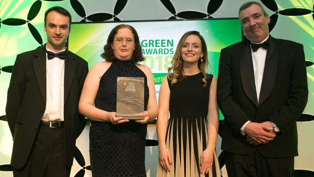 John Keohane, CEO, Verde LED presents The Green Professional Services award to John Gray, Gemma Osaseyi & Eimear Dempsey, Deloitte.