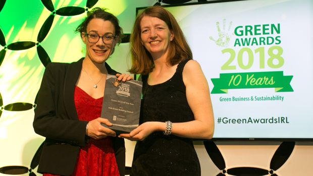 Bernie Kiely, Assistant Principal, in the Waste and Resource Efficiency Division, Department of Communications, Climate Action & Environment, presents the Green NGO of the Year award to Marion Jammet, Irish Green Building Council.