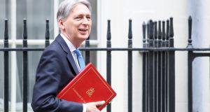 Philip Hammond, Britain's chancellor of the exchequer, leaves number 11 Downing Street on Tuesday to present the Spring Statement. Photograph: Simon Dawson/Bloomberg