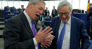 Brexit campaigner Nigel Farage MEP (left) speaks to European Commission president Jean-Claude Juncker ahead of a debate on the guidelines on the framework of future EU-UK relations at the European Parliament in Strasbourg. Photograph: Vincent Kessler/Reuters.