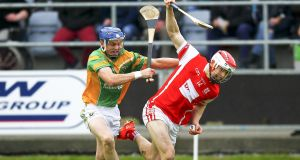 Cuala's Con O'Callaghan tussels with  Enda Grogan of Kilcormac-Killoughey in the Leinster SHC final at O'Moore Park, Portlaoise, Co.Laois. Photograph: Inpho