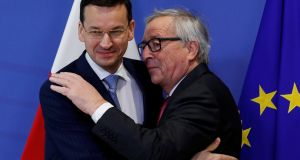 Poland's prime minister Mateusz Morawiecki with European Commission president Jean-Claude Juncker in Brussels last week. Photograph: Yves Herman/Reuters