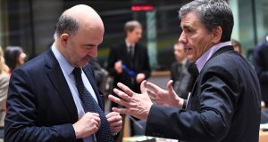 European tax commissioner Pierre Moscovici and Greece's finance minister, Euclid Tsakalotos, at the Ecofin meeting in Brussels on Tuesday. Photograph: Emmanuel Dunand/AFP/Getty Images