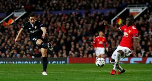 Sevilla's Wissam Ben Yedder scores his first goal in the Champions League round of 16 second leg against  Manchester United at Old Trafford. Photograph: Jason Cairnduff/Action Images via Reuters
