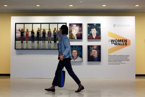 Accenture Ireland's Women on Walls portraits viewed by a passerby at the 62nd United Nations Commission on the Status of Women in New York, which is being chaired by Ireland for the first time.