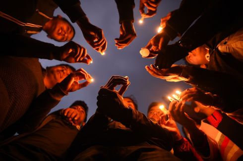 Nepali people take part in a candlelight vigil in memory of the aircraft crash victims in Kathmandu. Photograph: AFP/Getty Images