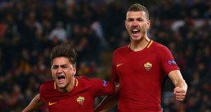 Roma's Edin Dzeko celebrates with Cengiz Under after scoring their first goal in the Champions League round of 16 second leg against Shakhtar Donetsk at Stadio Olimpico. Photograph: Max Rossi/Reuters