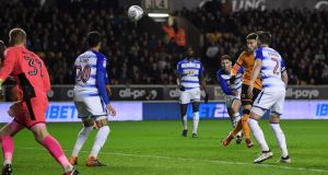 Matt Doherty of Wolverhampton Wanders heads in the opening goal during the Sky Bet Championship match against Reading at Molineux. Photograph: Gareth Copley/Getty Images