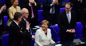 German Chancellor Angela Merkel (C) is applauded after she was re-elected   at the Bundestag in Berlin. Photograph: John MacDougall/AFP/Getty Images