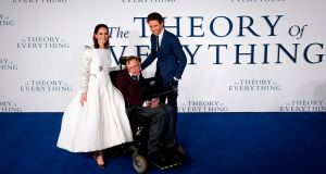 "British actors Felicity Jones  and Eddie Redmayne  pose with  Stephen Hawking  at the premiere of the ""The Theory of Everything"" in London. Photograph: Justin Tallis/Getty Images"