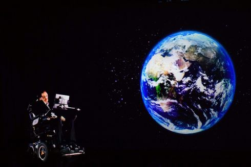 Stephen Hawking, who has died aged 76, speaks to an audience by hologram  in Hong Kong, beamed live from his office in Cambridge, England in 2017. Photograph: Anthony Wallace / AFP