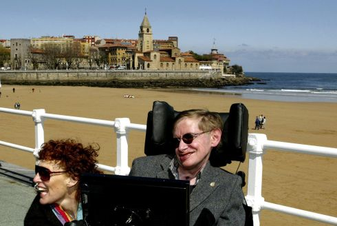 British astrophysicist Stephen Hawking (R) and his wife Elaine pose in front of the San Lorenzo beach in the northern Spanish city of Gijon April , 2005.  Photograph: Alonso Gonzales/Reuters
