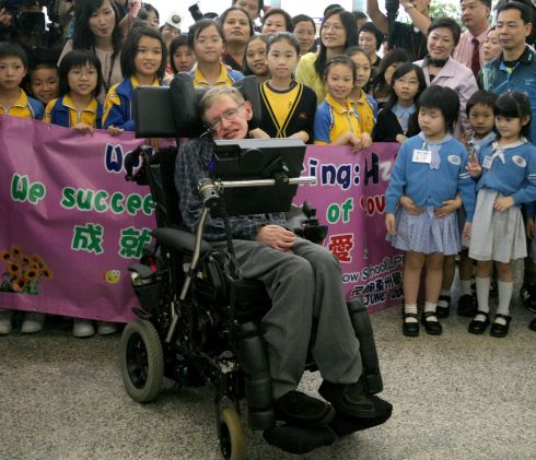 British theoretical physicist and mathematician Stephen Hawking (C) arriving at Hong Kong's international airport, 2006.  Photograph: Samantha Sinsa / AFP