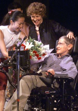 Stephen Hawking, the world-renowned physicist, receiving a bouquet of flowers after his lecture in Beijing, 2002. Photograph: AFP