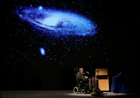 "British physicist Stephen Hawking delivers a lecture on ""The Origin of the Universe"" at the Heysel conference hall in Brussels, 2007.    Photograph: Francois Lenoir/Reuters"