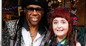 Chic co-founder Nile Rodgers with fashion designer Claire Garvey.