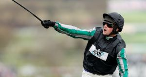 Nico de Boinville celebrates after riding Altior to victory in the Queen Mother Champion Chase Action. Photograph: Matthew Childs/Reuters