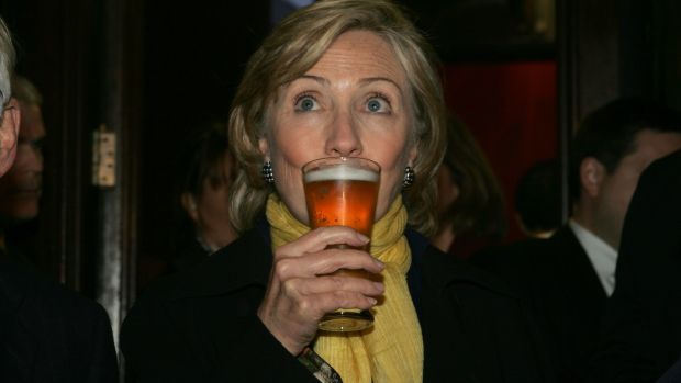Hillary Clinton enjoys a beer at McDaid's Pub on Harry Street, Dublin in 2009. Photograph: Cyril Byrne