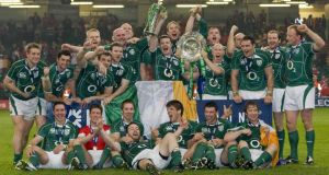The Ireland team celebrate winning the Grand Slam at the Millennium Stadium in Cardiff. Photograph: Morgan Treacy/Inpho