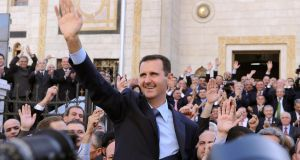 Syrian president Bashar al-Assad waving at supporters after addressing parliament in Damascus in March 2011. Photograph: AFP/Getty Images