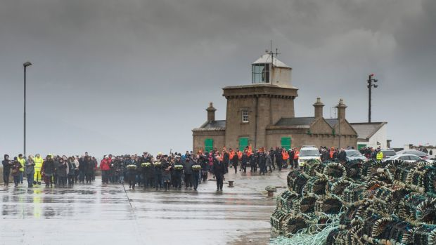A memorial service and wreath-laying ceremony at Blacksod Light house and Pier, Belmullet, Co Mayo. Photograph: Michael McLaughlin