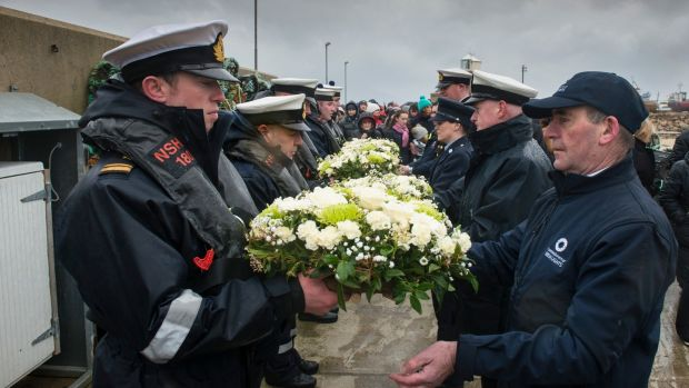 Sombre occasion: Naval Service Personnel at the memorial service. Photograph: Michael McLaughlin