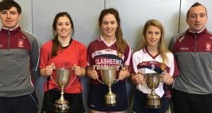 Cian Treacy and Barry Ryan (right ) with the captains of the Munster-winning teams:   Katie Ryan (soccer),  Anna Gavin (camogie) and  Aoife Maher (football).