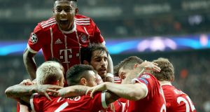 Bayern Munich  celebrate after  Thiago Alcantara (No 6) scored their  opening goal in the Champions League round of 16 second leg against Besiktas in Istanbul. Photograph: Erdem Sahin/EPA