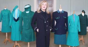 Irish fashion designer Louise Kennedy with a range of former Aer Lingus crew uniforms. Ms Kennedy has been engaged by Aer Lingus to create a new design for its uniform. Photograph: Leon Farrell/Photocall