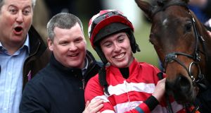 Trainer Gordon Elliott and jockey Jack Kennedy  after winning the Fred Winter Juvenile Handicap Hurdle on Veneer of Charm  at Cheltenham Racecourse. Photograph: Tim Goode/PA Wire