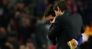 Antonio Conte congratulates Lionel Messi after Barcelona's win over Chelsea. Photograph: Susana Vera/Reuters