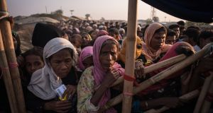 Rohingya Muslim refugees wait to be called to receive food aid of rice, water and cooking oil in a relief centre at the Kutupalong refugee camp in Cox's Bazaar, Bangladesh, last last year. File photograph: Ed Jones/AFP/Getty Images