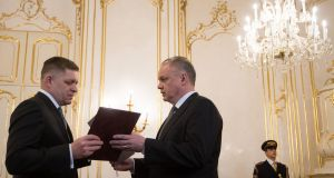 Slovak prime minister Robert Fico tenders President Andrej Kiska  his resignation letter  in Bratislava. Photograph: Vladimir Simicek/AFP/Getty