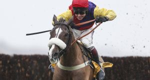 Richard Johnson riding Native River to victory in  The Betfair Denman Steeple Chase at Newbury in  February.  Photograph:  Alan Crowhurst/Getty Images