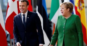 "French president Emmanuel Macron and Germany's chancellor Angela Merkel: ""We have made clear in our coalition agreement that we are ready to provide more money for the EU budget,"" says Dr Merkel.  Photograph:  Francois Lenoir/Reuters"
