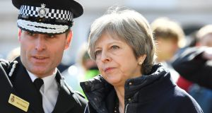 British prime minister Theresa May on a visit to Salisbury, where former Russian intelligence officer Sergei Skripal and his daughter Yulia were poisoned with a nerve agent last week. Photograph: Toby Melville/Reuters