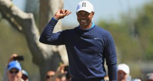 Tiger Woods reacts after sinking a long birdie putt on the seventh hole during the first round at the Arnold Palmer Invitational at Bay Hill Club and Lodge in Orlando, Florida. Photograph: Mike Ehrmann/Getty Images