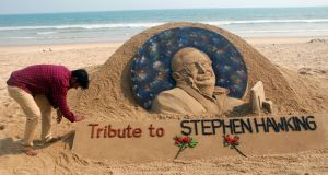 Indian sand artist Sudarsan Pattnaik creates a sand sculpture in honour of the late Stephen Hawking, at Puri beach in  India, this week. Photograph:  STR/EPA