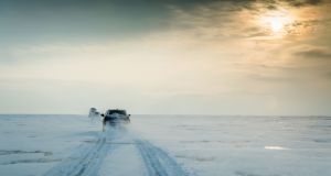 The convoy of Mazdas makes it away across the Siberian ice