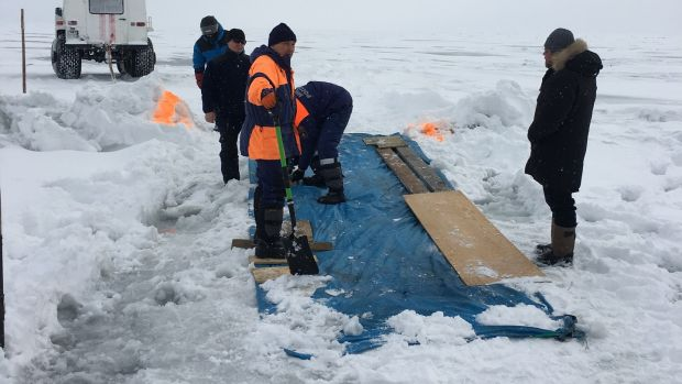 Alex (right) supervises construction of the makeshift crossing of the crack in the ice