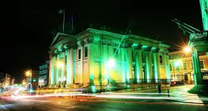 City Hall in Dublin is illuminated in green for the four-day-long St Patrick's festival. Photograph: Brian Lawless/PA Wire